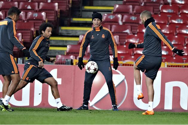 CAPTION CORRECTS ID OF PLAYER TO THE LEFT TO MARCELO VIEIRA Real Madrid's  Ronaldo,  centre, and Marcelo Vieira left , during a training session, at Parken Stadium, in Copenhagen, Denmark, Monday,
