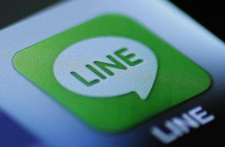 """The icon of a free communication app """"Line"""" is pictured on an Apple Inc's iPhone in this photo illustration in Tokyo"""