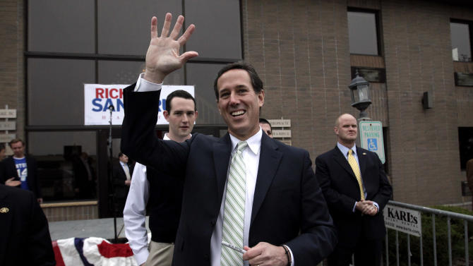 Republican presidential candidate, former Pennsylvania Sen. Rick Santorum waves as he visits the campaign headquarters in Brookfield, Wis., Saturday, March 31, 2012. (AP Photo/Jae C. Hong)