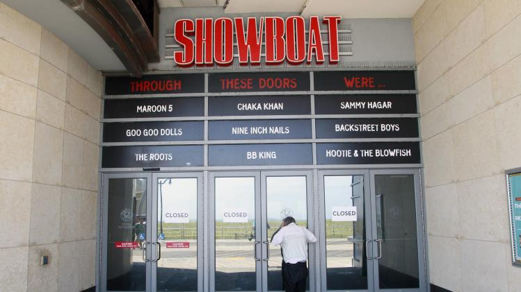 A man tries to peek into the closed Showboat Casino Hotel in Atlantic City
