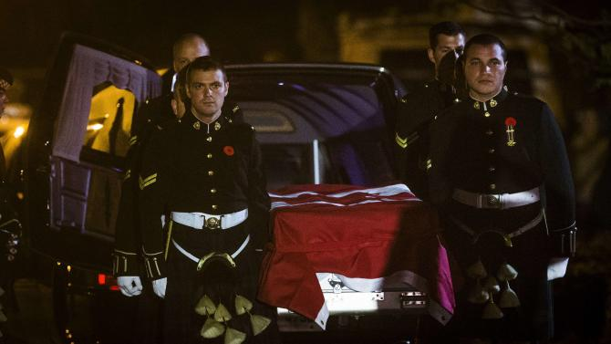 Pallbearers from Argyll and Sutherland Highlanders of Canada regiment carry the remains of Corporal Nathan Cirillo at a funeral home in Hamilton