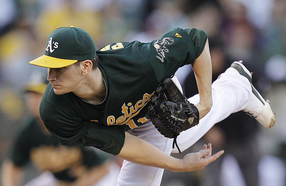 Oakland Athletics' Jarrod Parker works against the Los Angeles Angels in the first inning of a baseball game, Monday, Aug. 6, 2012, in Oakland, Calif. (AP Photo/Ben Margot)