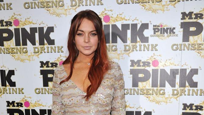 FILE - In this Oct. 11, 2012 file photo, Lindsay Lohan attends the Mr. Pink Ginseng launch party at the Beverly Wilshire hotel in Beverly Hills, Calif.  Lohan's misdemeanor case is due to be called for arraignment in Los Angeles on Tuesday, January 15, 2012. The actress is charged with lying to police, reckless driving and obstructing a police officer from performing his duties. Photo by Richard Shotwell/Invision/AP, File)