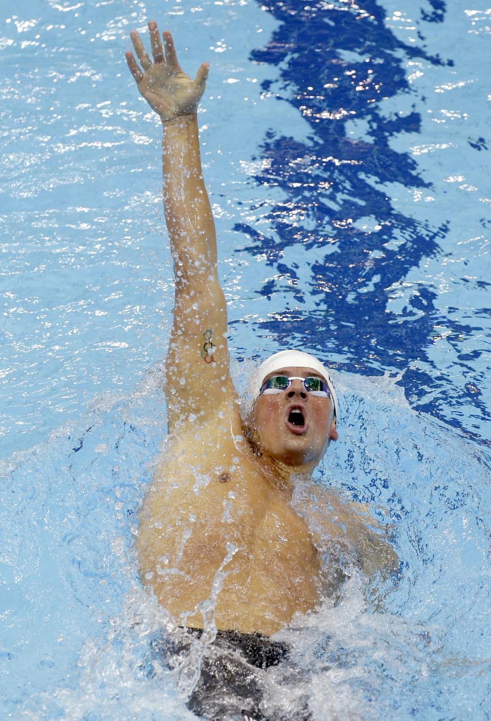 USA's Ryan Lochte competes in a heat of the men's 400-meter individual medley at the Aquatics Centre in the Olympic Park during the 2012 Summer Olympics in London, Saturday, July 28, 2012. (AP Photo/Lee Jin-man)