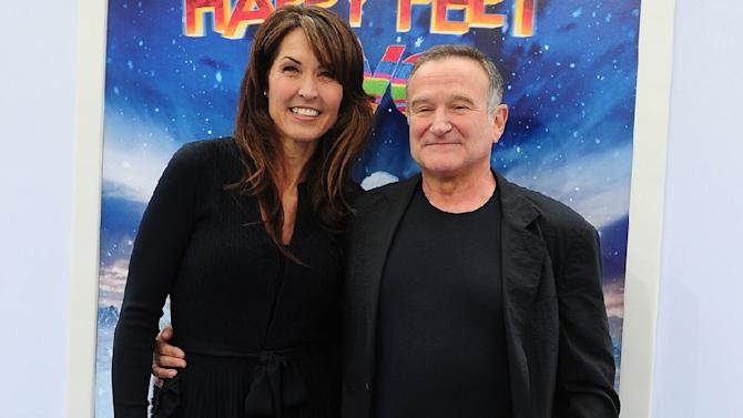 "Robin Williams and his wife Susan Schneider at the world premiere of ""Happy Feet Two"" in Hollywood on November 13, 2011"