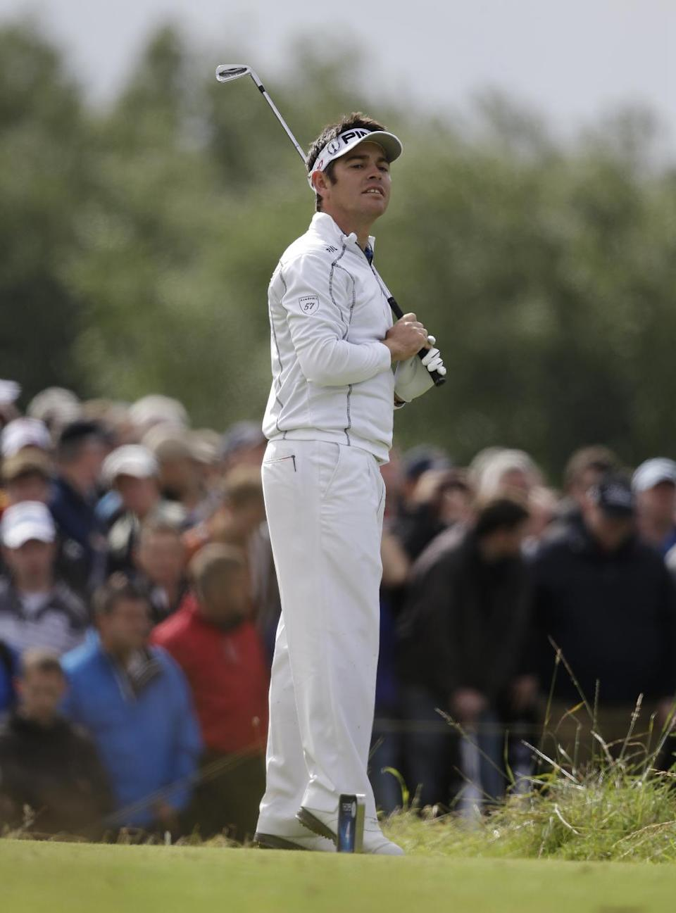 Louis Oosthuizen of South Africa looks for the ball after his shot off the fourth tee at Royal Lytham & St Annes golf club during the second round of the British Open Golf Championship, Lytham St Annes, England, Friday, July 20, 2012. (AP Photo/Tim Hales)