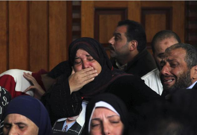 Family members from the 74 soccer fans killed in violence in a stadium in 2012 cry at an appeal court in Cairo