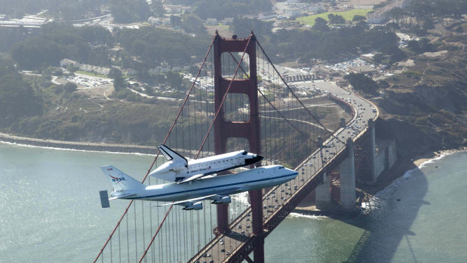 In this photo provided by NASA, space shuttle Endeavour and its 747 carrier aircraft soar over the Golden Gate Bridge in San Francisco during the final portion of its tour of California, Friday, Sept. 21, 2012. (AP Photo/NASA, Carla Thomas)