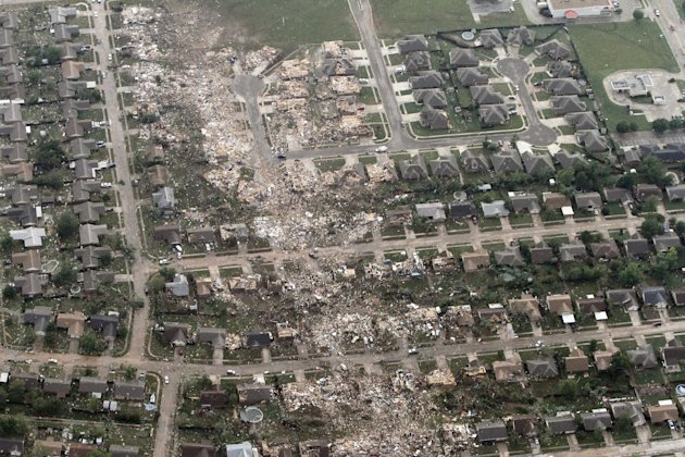 This aerial photo shows the remains of homes hit by a massive tornado in Moore, Okla., Monday May 20, 2013. A tornado roared through the Oklahoma City suburbs Monday, flattening entire neighborhoods,