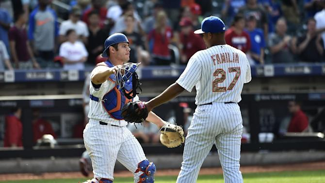 New York Mets catcher Anthony Recker (20) embraces New York Mets relief pitcher Jeurys Familia (27) after the Mets beat the Philadelphia Phillies in a baseball game at Citi Field on Monday, May 25, 2015, in New York. (AP Photo/Kathy Kmonicek)