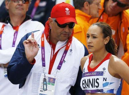 Britain's Jessica Ennis talks to her coach Toni Minichiello during her women's heptathlon high jump Group A event at the London 2012 Olympic Games at the Olympic Stadium