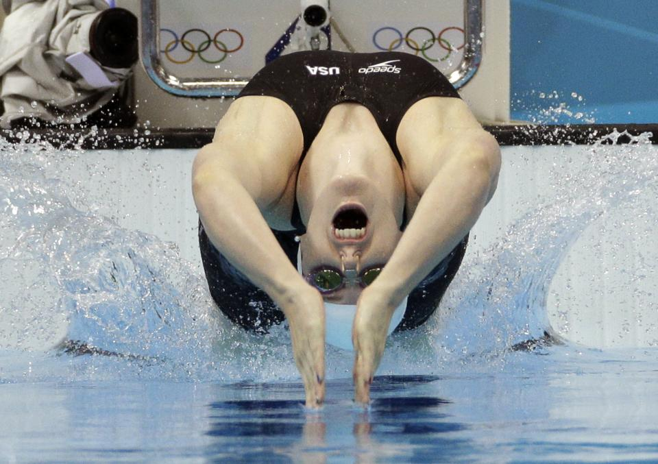 United States' Missy Franklin starts in a women's 100-meter backstroke swimming heat at the Aquatics Centre in the Olympic Park during the 2012 Summer Olympics in London, Sunday, July 29, 2012. (AP Photo/Michael Sohn)