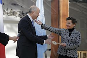 French Foreign Minister Laurent Fabius hands over …