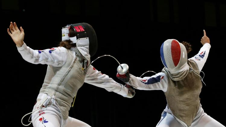 Jeon of South Korea competes against Thibus of France in the women's team foil final match at the World Fencing Championships in Kazan