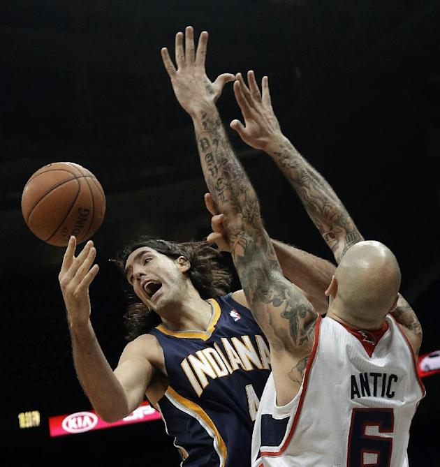 Indiana Pacers power forward Luis Scola (4), of Argentina, loses control of the ball as Atlanta Hawks power forward Pero Antic (6) defends in the first half of a preseason NBA basketball game Tuesday,