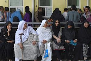 Afghan women wait as they apply for passports in Kabul …