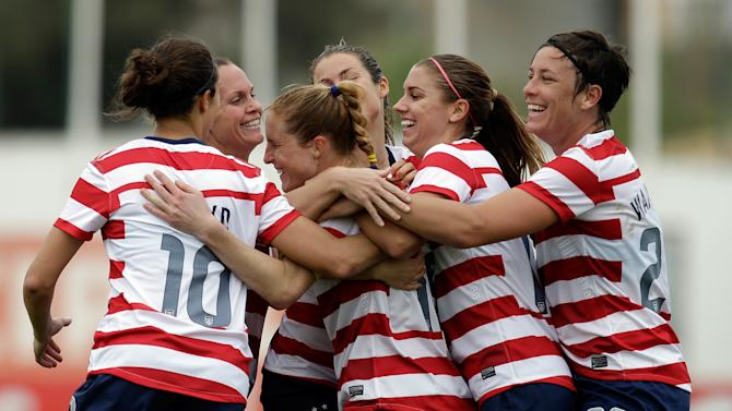 Rachel Buehler of the U.S., third from left, celebrates after scoring the opening goal against Iceland during their Algarve Cup women's soccer match in Albufeira, southern Portugal, Wednesday, March 6, 2013. (AP Photo/Armando Franca)