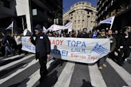 Thousands of protesters march in central Athens during a 24-hour general strike on February 20, 2013. The nationwide strike -- the first general work stoppage in Greece this year -- forced airport authorities to scrap or reschedule dozens of flights while hospitals operated on reduced staffing