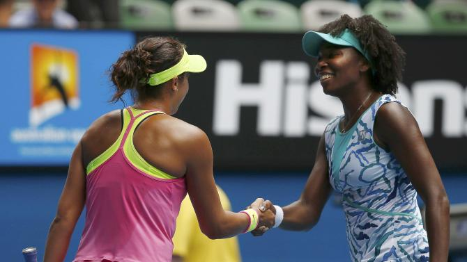 Keys of the U.S. shakes hands with compatriot Venus after winning their women's singles quarter-final match at the Australian Open 2015 tennis tournament in Melbourne