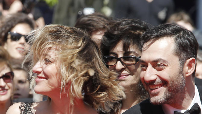 Director Valeria Bruni Tedeschi, left, and Filippo Timi arrive for the screening of A Castle in Italy at the 66th international film festival, in Cannes, southern France, Monday, May 20, 2013. (AP Photo/Francois Mori)
