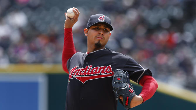 Cleveland Indians pitcher Carlos Carrasco throws against the Detroit Tigers in the first inning of a baseball game in Detroit, Sunday, April 26, 2015. (AP Photo/Paul Sancya)