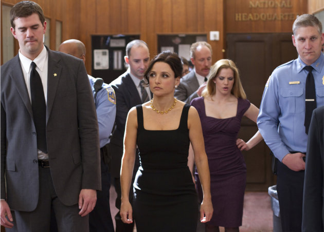 "Tony Hale as Gary Walsh, Julia Louis-Dreyfus as Selina Meyer, Matt Walsh as Mike Mclintock, and Anna Chlumsky as Amy Brookheimer in ""Veep."""