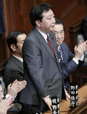 Yoshihiko Noda, new leader of the ruling Democratic Party of Japan, stands after Japan's lower house elected Noda as the country's new prime minister, at the parliament in Tokyo Tuesday, Aug. 30, 2011. (AP Photo/Koji Sasahara)