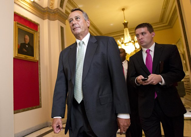 House Speaker John Boehner of Ohio, left, leaves the House chamber on Capitol Hill in Washington, Wednesday, July 11, 2012, after the Republican-controlled House voted 244-185 to repeal President Barack Obama&#39;s health care law. (AP Photo/J. Scott Applewhite)