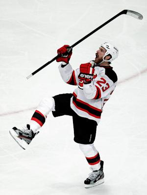 New Jersey Devils' David Clarkson celebrates after scoring a goal against the New York Rangers during the third period of Game 2 of an NHL hockey Stanley Cup Eastern Conference final playoff series, Wednesday, May 16, 2012, at New York's Madison Square Garden. (AP Photo/Julio Cortez)