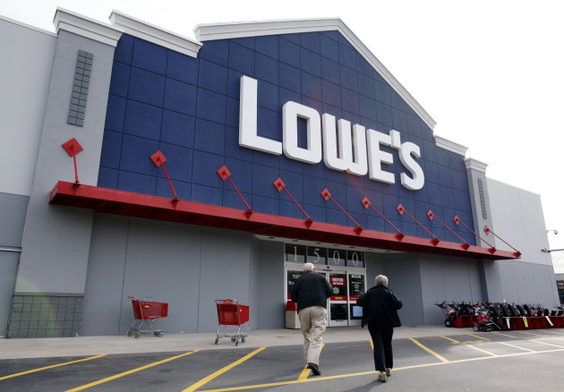 FILE -- In a Nov. 14, 2011 file photo, customers walk toward the Lowe&#39;s store in Saugus, Mass. Lowe&#39;s Cos.&#39;reported Monday May 21, 2012, first-quarter profit climbed 14 percent, as warmer weather helped boost sales. (AP Photo/Michael Dwyer/file)
