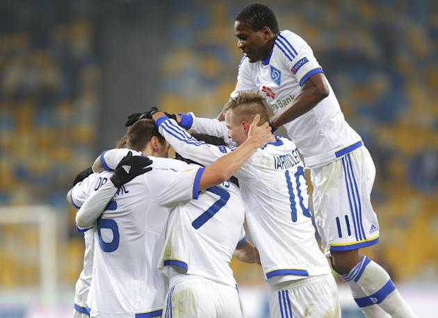 FC Dynamo Kyiv's players celebrate after Jeremain Lens scored a goal during their Europa League group G soccer match against SK Rapid Wien, in Kiev, Ukraine, Thursday, Dec. 12, 2013