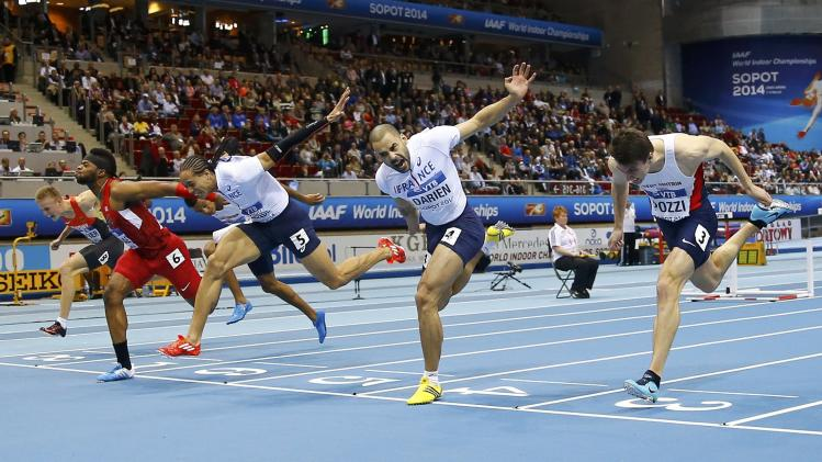 Athletes finish in the men's 60 metres hurdles final at the world indoor athletics championships at the ERGO Arena in Sopot