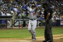 Los Angeles Dodgers' Matt Kemp reacts as he crosses the plate after hitting a home run during the sixth inning of a baseball game against the Milwaukee Brewers Monday, May 20, 2013, in Milwaukee. (AP Photo/Morry Gash)
