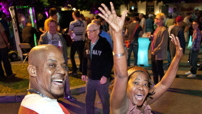 IMAGE DISTRIBUTED FOR AIDS HEALTHCARE FOUNDATION - Byron Rankins and Marlene Charlot dance to the music of Y100 radio at the Wilton Manors Out of the Closet (OTC) Block Party & Insti-Test Launch Marking the 5th anniversary of Wilton Manors OTC in Wilton Manors, Fla. on Saturday, Feb. 2, 2013 at the Hagan Park/City Hall parking lot in Wilton Manors, Fla. (Mitchell Zachs/AP Images for AIDS Healthcare Foundation)