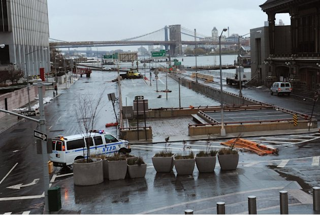 Water reaches the street level of the flooded Brooklyn Battery Tunnel, Tuesday, Oct. 30, 2012, in New York. Sandy arrived along the East Coast and morphed into a huge and problematic system, putting m
