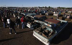 Potential buyers and car enthusiasts check out vintage automobiles from the Lambrecht Collection in Pierce, Nebraska