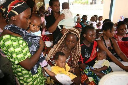 Women and their children visit a clinic at Sinza Health Centre in Tanzania's capital Dar es Salaam