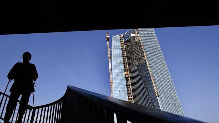 Woman descends steps from bridge next to ECB construction site in Frankfurt