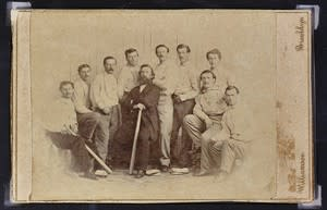 This photo released Wednesday, Jan. 9, 2013 by the Saco River Auction Co., in Biddeford, Maine, shows a rare 1865 baseball card of the Brooklyn Atlantics, discovered in a photo album bought at a yard sale in Baileyville, Maine, on the Canadian border. The auction house expects six-figure bids at its Feb. 6 auction. (AP Photo/ Saco River Auction Co.)