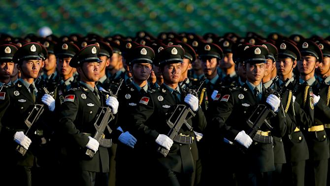 Chinese PLA troops practise marching as they arrive at Tiananmen Gate for a military parade to commemorate the 70th anniversary of the end of World War Two in Beijing