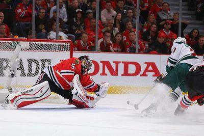 Corey Crawford appears dazed after shot off helmet, remains in game anyway