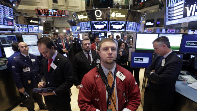 Traders on the floor of the New York Stock Exchange observe a minute of silence before the opening bell in honor of Sandy Hook Elementary School victims and their families, Friday, Dec. 21, 2012. Stocks opened sharply lower Friday on Wall Street after House Republicans called off a vote on tax rates and left federal budget talks in disarray 10 days before sweeping tax increases and government spending cuts take effect. (AP Photo/Richard Drew)