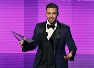 Musician Justin Timberlake accepts the favorite pop/rock male artist award at the 41st American Music Awards in Los Angeles