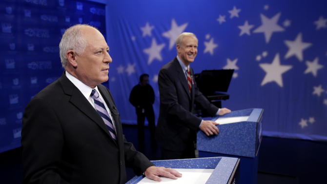 Democratic Gov. Pat Quinn, left, and Republican challenger Bruce Rauner meet for a third debate before the Nov. 4 election Monday, Oct. 20, 2014, in Chicago. (AP Photo/Charles Rex Arbogast)