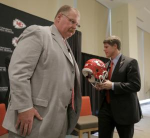 New Kansas City Chiefs NFL team head football coach Andy Reid, left, and owner Clark Hunt leave the stage after a news conference at Arrowhead Stadium Monday, Jan. 7, 2013, in Kansas City, Mo. (AP Photo/Charlie Riedel)