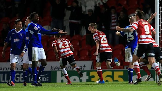 Doncaster Rovers' Jordan Ball (25) celebrates after scoring the winning goal after he had only been on the pitch for a few seconds