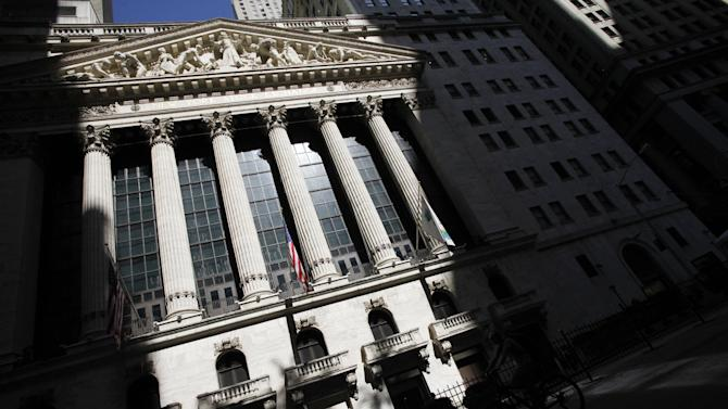 FILE - This July 15, 2013, file photo, shows the New York Stock Exchange in New York. The Shanghai share index fell the most since early 2007 on Monday, July 27, 2015, as Chinese stocks suffered a renewed sell-off despite government efforts to calm the market. (AP Photo/Mark Lennihan, File)