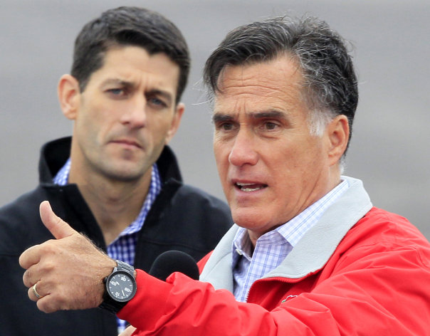 Republican presidential candidate former Massachusetts Gov, Mitt Romney speaks during a campaign rally with his running mate Rep. Paul Ryan, R-Wis., left, Tuesday, Sept. 25, 2012, at Wright Brothers Aviation in Vandalia, Ohio. (AP Photo/Al Behrman)