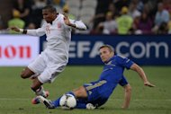 Andriy Shevchenko (right) takes on England&#39;s Ashley Young during the Euro 2012 match in Donetsk on June 19. Shevchenko on Saturday said he is joining a pro-business political party after announcing that he was quitting football for politics