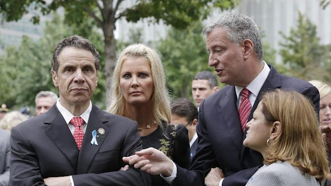 """FILE- In this Sept. 11, 2014 file photo, New York Gov. Andrew Cuomo, left, listens to Mayor Bill de Blasio during memorial observances held at the site of the World Trade Center in New York. The past couple of weeks have been tense once between the two Democrats and there is no sign of improvement. De Blasio on Thursday, July 9, did not back down in his ongoing feud with Cuomo, doubling down on his criticisms of Albany, rebuffing a call for a """"pasta summit"""" to clear the air and vowing he would continue to call out further obstructions from his friend-turned-foe. (AP Photo/Mark Lennihan, Pool)"""